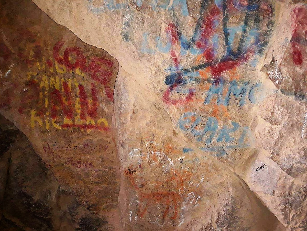vandalism of the rock art in the Anzota Caves in Chile.