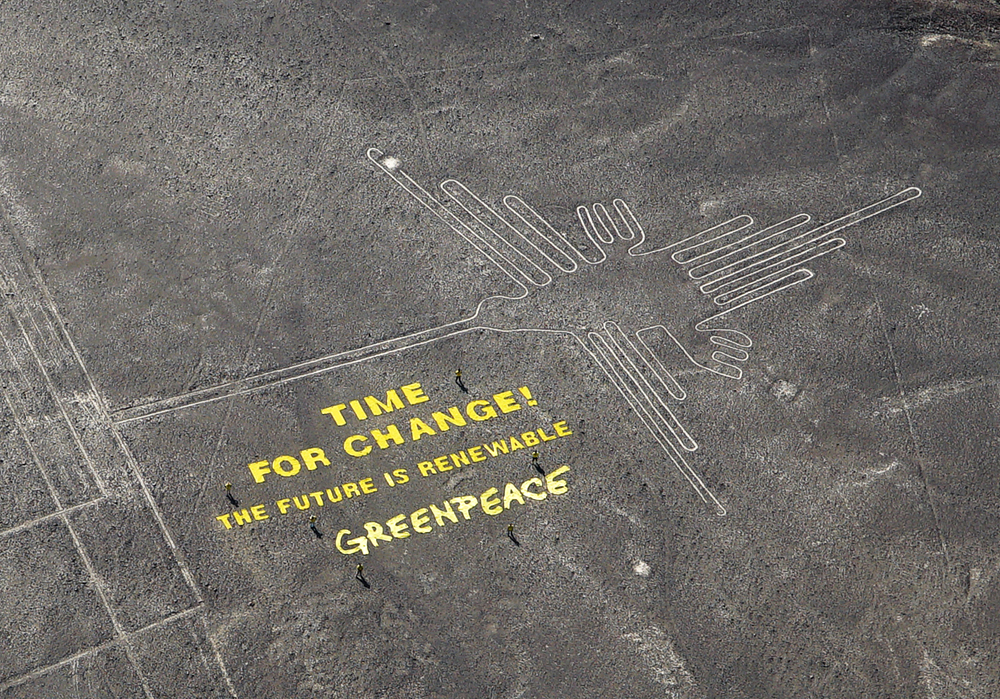 Greenpeace protest with message at Nazca lines in Peru