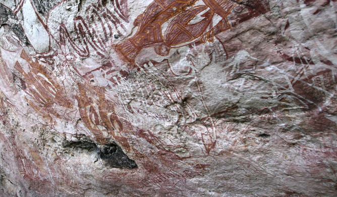 Rock art of Australia being removed by feral animals rubbing against the wall.