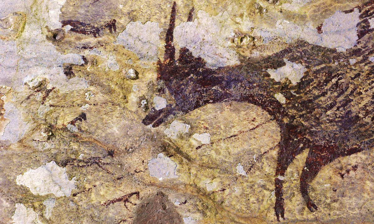 World's oldest art under threat cement mining Indonesia mine figurative paintings world