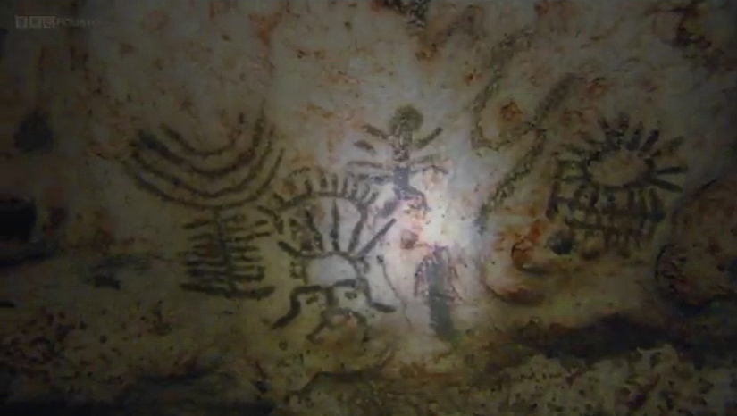Dr Jago Cooper studies the cave paintings, or pictographs, which researchers believe depicted the Taino origin myth